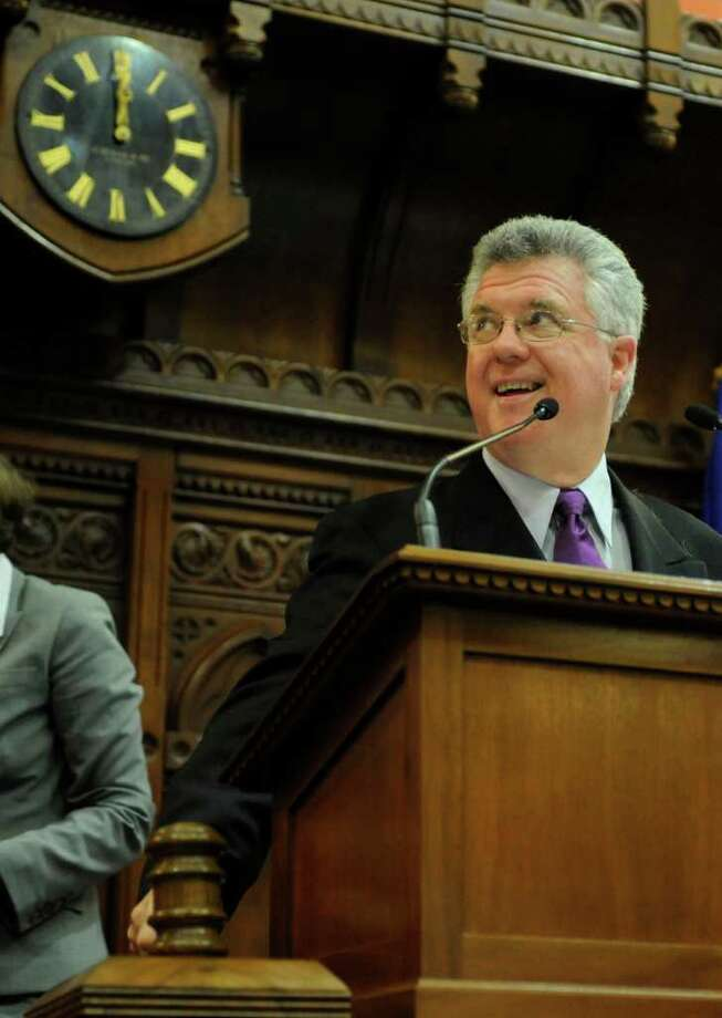 Speaker of the House Chris Donovan, D-Meriden, looks at the tally board in the final minutes of the last day of session at the Capitol in Hartford June 8, 2011. Donovan, eyeing Chris Murphy's 5th district congressional seat, is programming Greenwich into his fundraising GPS. Several Democrats from town and from Stamford are scheduled to hold a fundraiser for Donovan Monday night, Sept. 26, 2011, at Bistro Morello on Greenwich Avenue. (AP Photo/Jessica Hill) Photo: Jessica Hill, ST / AP2011