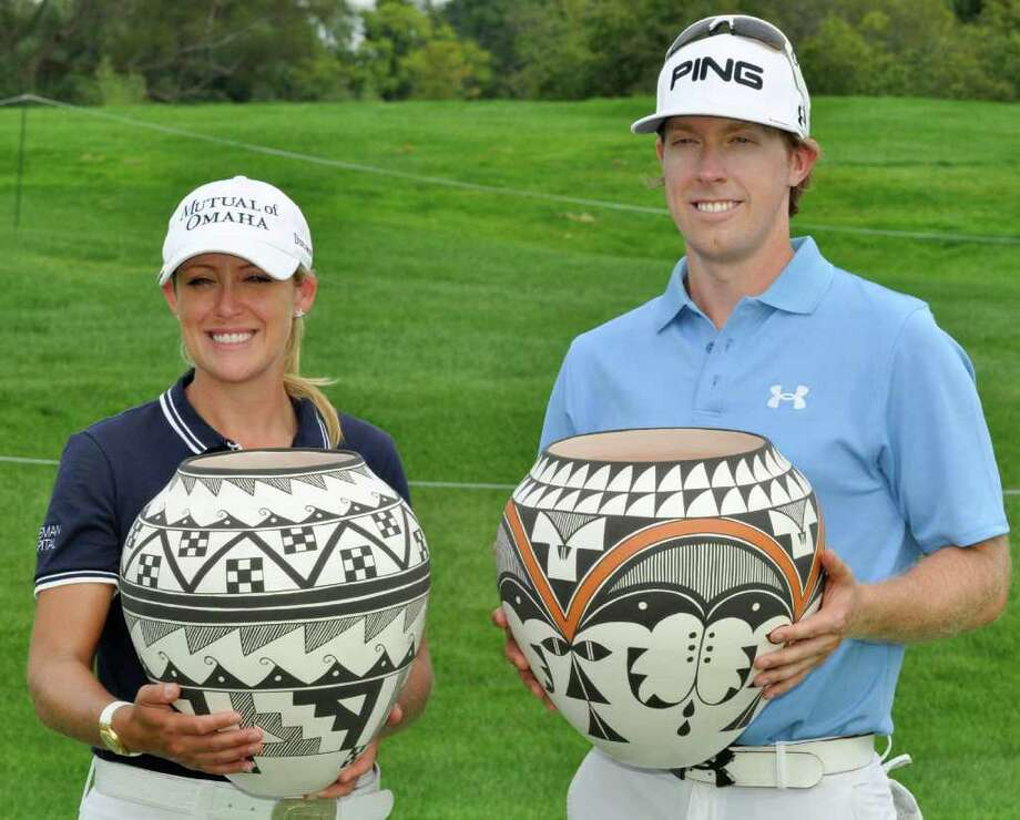 Cristie Kerr, left, and Hunter Mahan pose with their trophies after winning the Notah Begay III Foundation Challenge golf tournament in Verona, N.Y., Wednesday, Aug. 31, 2011. (AP Photo/Kevin Rivoli) Photo: Kevin Rivoli / FR60349 AP