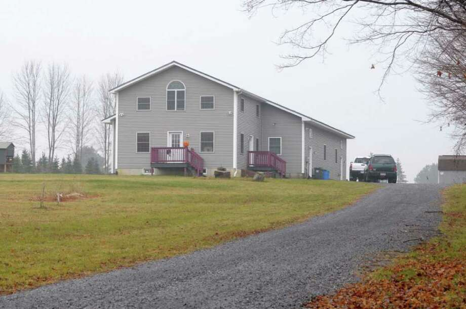 A Department of State investigation has found the town of Galway violated numerous zoning laws when it approved construction of an airplane hangar attached to this home at 1182 Perth Road in Galway, NY, seen here on Tuesday, Nov. 23, 2010.    (Paul Buckowski / Times Union) Photo: Paul Buckowski / 00011180A