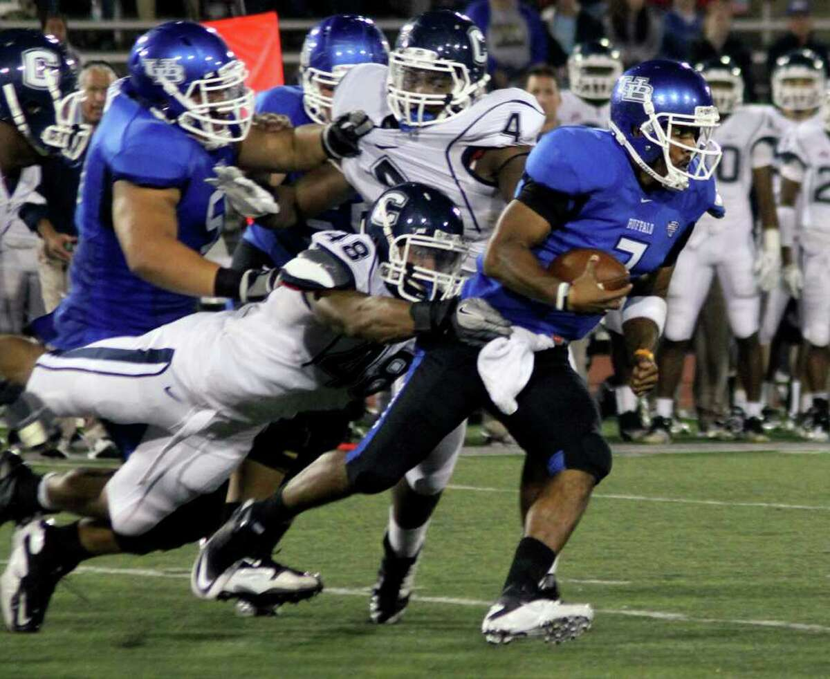 UConn's Trevardo Williams (48) tackles Buffalo quarterback Chazz Anderson in Amherst , N.Y., on Saturday night.