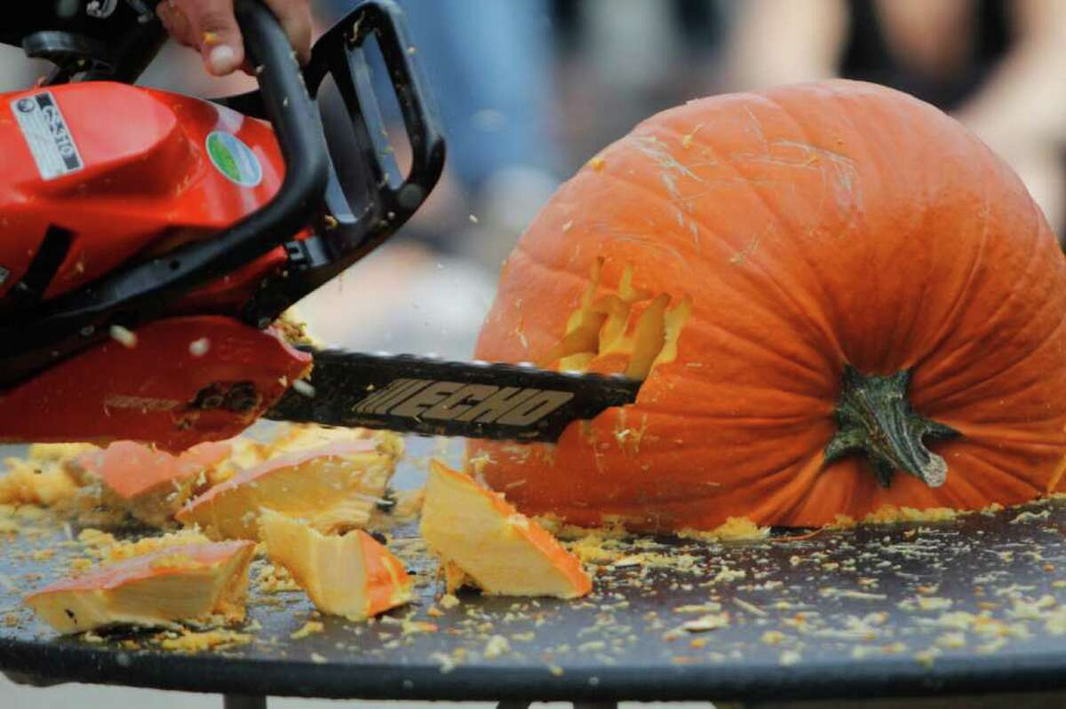 Rob Beck competes in the Texas Chainsaw Pumpkin Carving competition.