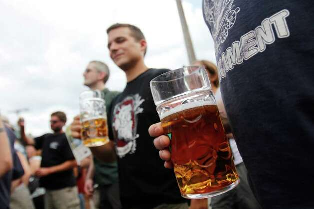 People enjoy beers  from over 80 microbrews at the Fremont Oktoberfest tasting garden in Seattle on Saturday Sept. 24, 2011. Photo: JOE DYER / SEATTLEPI.COM