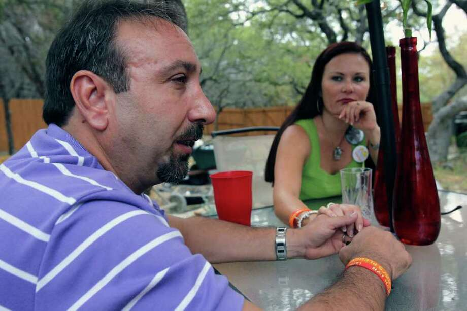 Brett Cavaliero struggles and his wife Kristie Reeves-Cavaliero comforts him as he explains the events on the morning of the accidental death of their daughter. Photo: TOM REEL, Tom Reel/Express-News / © 2011 San Antonio Express-News