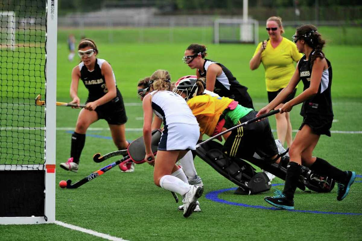 Blaney Rotanz, center, scores Staples' sixth goal in a 6-1 win over Trumbull Thursday. Lady Wrecker Shelby Phares is on the right.