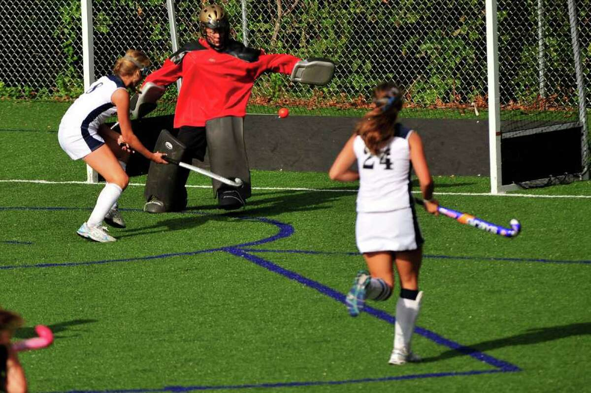 Staples sophomore Noortje Lueb scores one of her two goals in a 6-1 victory over Trumbull Thursday.
