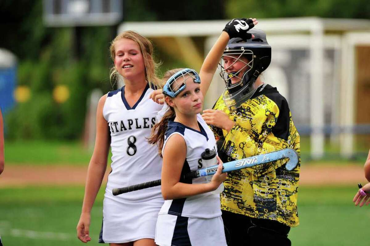Josie Fair (middle) congratulates Staples goalkeeper Chris Lueb after ta 6-1 victory over Trumbull Thursday. Chris' sister Noortje Lueb on the left. Noortje scored twice in the victory.