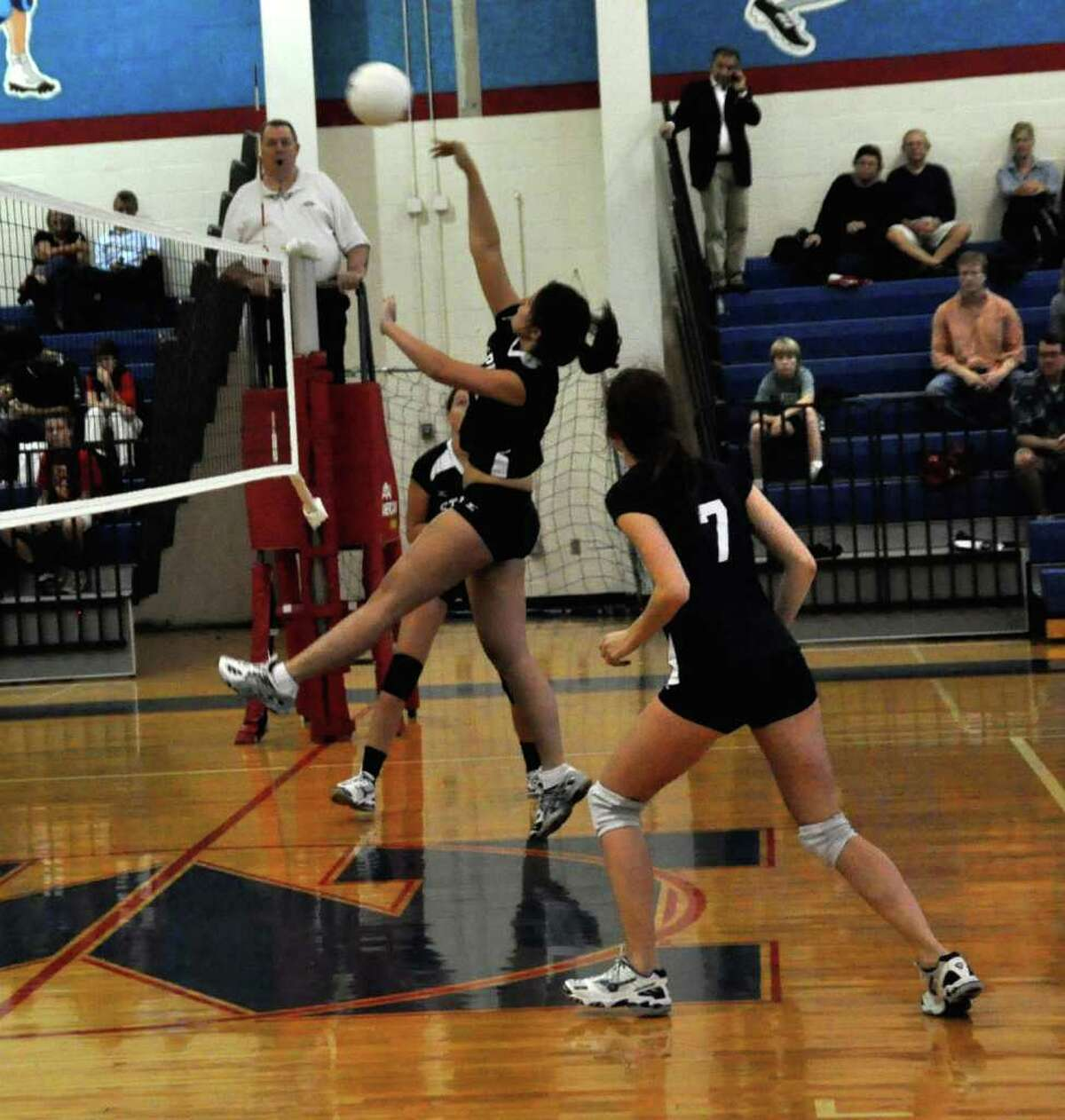 Jen Dimitrief returns it for Staples Friday in a 3-0 win at Brien McMahon.
