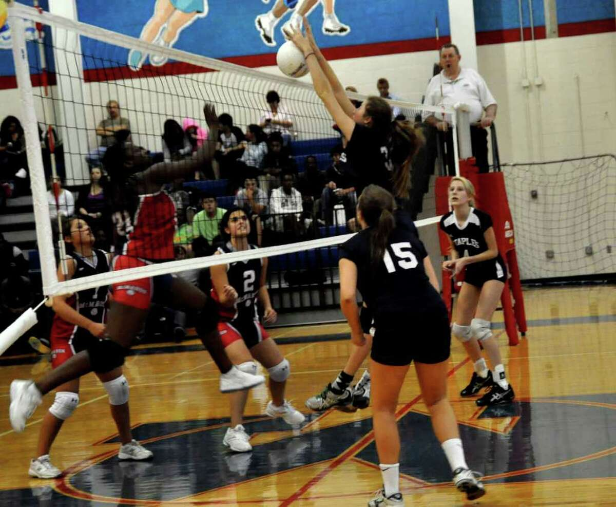 Cheyenne Haslett goes for the block for Staples in its 3-0 win at Brien McMahon Friday.