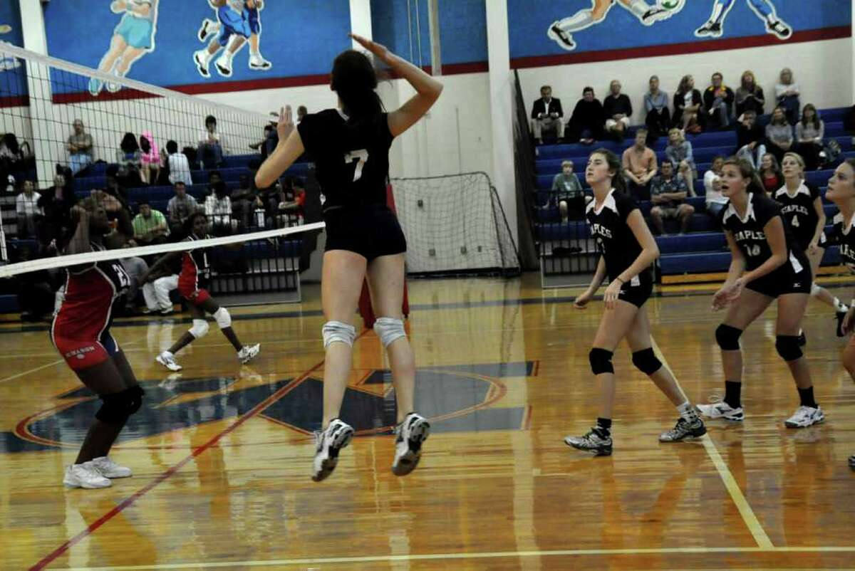 Lindsay Graber prepares to swat it for Staples in its 3-0 victory at Brien McMahon Friday.