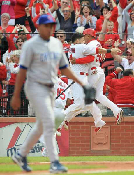CHRIS LEE: ST. LOUIS  POST-DISPATCH/MCT WILD FINISH: Yadier Molina and Adron Chambers, right, celebrate the Cardinals' game-winning run on Carlos Marmol's wild pitch. Photo: Chris Lee / St. Louis Post-Dispatch