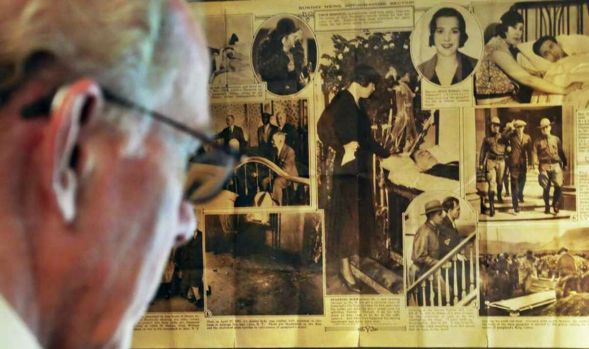Author William Kennedy before a framed newspaper pictorial on the life of Legs Diamond at Kennedy's Albany townhouse Wednesday Sept. 14, 2011. (John Carl D'Annibale / Times Union)