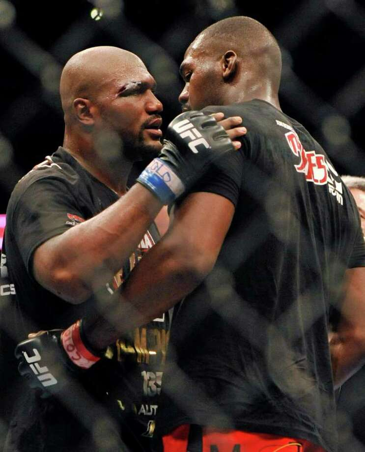 Jon Jones, right, of Endicott, N.Y., is congratulated by Rampage Jackson, of Irvine, Calif., after Jones knocked him out in the fourth round of their UFC Light Heavyweight title bout, Saturday, Sept. 24, 2011, in Denver. Jones won the fight with a knockout in the fourth round. (AP Photo/ Jack Dempsey ) Photo: JACK DEMPSEY, Associated Press / FR42408 AP