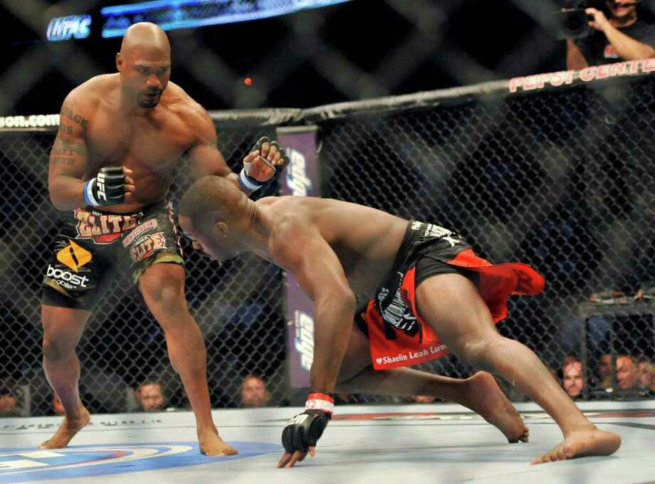 Jon Jones, right, of Endicott, N.Y., and Rampage Jackson, of Irvine, Calif., battle during the first round of their UFC Light Heavyweight title bout, Saturday, Sept. 24, 2011, in Denver.  (AP Photo/ Jack Dempsey ) Photo: JACK DEMPSEY, Associated Press / FR42408 AP