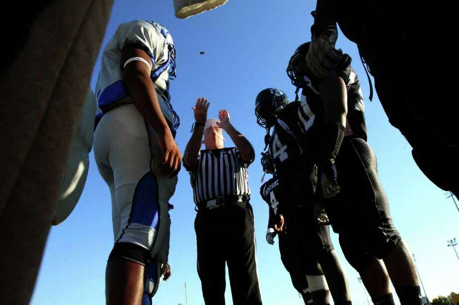 The coin flip before  Westside Wolves played against the Westbury Rebels in a District 20-5A high school football game at Butler Stadium in Houston, Texas.: Thomas B. Shea Photo: For The Chronicle: Thomas B. She