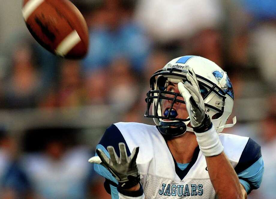 Receiver Sean Stier of the Johnson Jaguars hauls in a long pass against MacAarthur during 26-5A prep football action at Heroes Stadium on Saturday, Sept. 24, 2011. Photo: BILLY CALZADA, BILLY CALZADA / Gcalzada@express-news.net / gcalzada@express-news.net