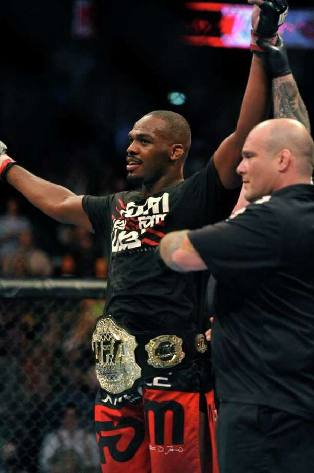 Jon Jones, of Endicott, N.Y., celebrates after beating Rampage Jackson, of Irvine, Calif., to retain his UFC Light Heavyweight title, Saturday, Sept. 24, 2011, in Denver.  Jones won the fight with a knockout in the fourth round. (AP Photo/ Jack Dempsey ) Photo: JACK DEMPSEY, Associated Press / FR42408 AP