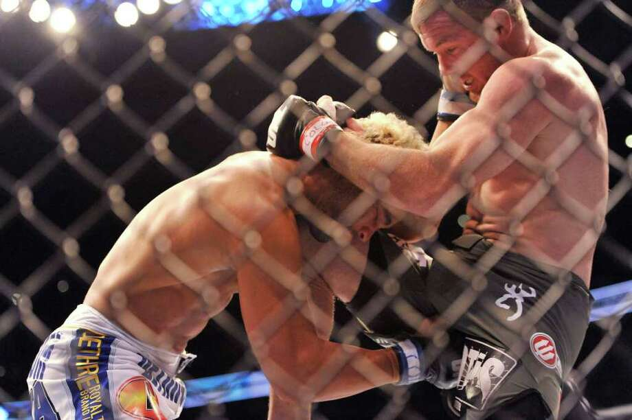 Matt Hughes, right, of Hillsboro, Ill., gets in a knee to the head of Josh Koscheck, of Fresno, Calif.,  during their UFC Welterweight bout, Saturday, Sept. 24, 2011, in Denver. Koscheck won the fight. (AP Photo/ Jack Dempsey ) Photo: JACK DEMPSEY, Associated Press / FR42408 AP