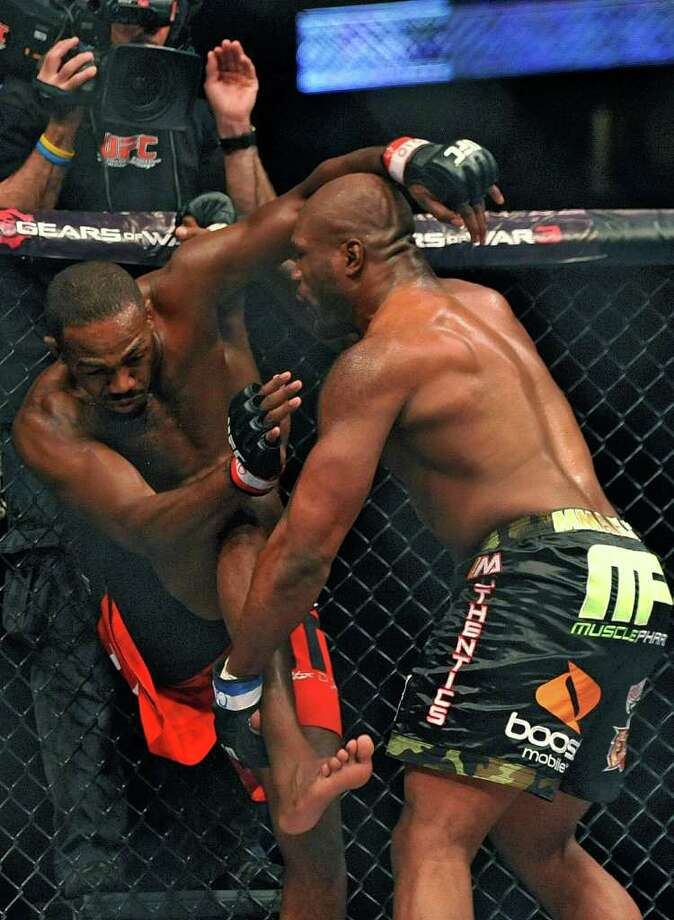Jon Jones, left, of Endicott, N.Y., and Rampage Jackson, of Irvine, Calif., fight during the second round of their UFC Light Heavyweight title bout, Saturday, Sept. 24, 2011, in Denver.  (AP Photo/ Jack Dempsey ) Photo: JACK DEMPSEY, Associated Press / FR42408 AP