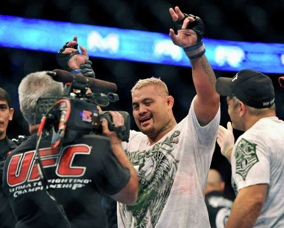 Mark Hunt, center, of Sydney, Australia, celebrates after defeating Ben Rothwell, of Kenosha, Wis., during their UFC Heavyweight bout, Saturday, Sept. 24, 2011, in Denver. (AP Photo/ Jack Dempsey ) Photo: JACK DEMPSEY, Associated Press / FR42408 AP