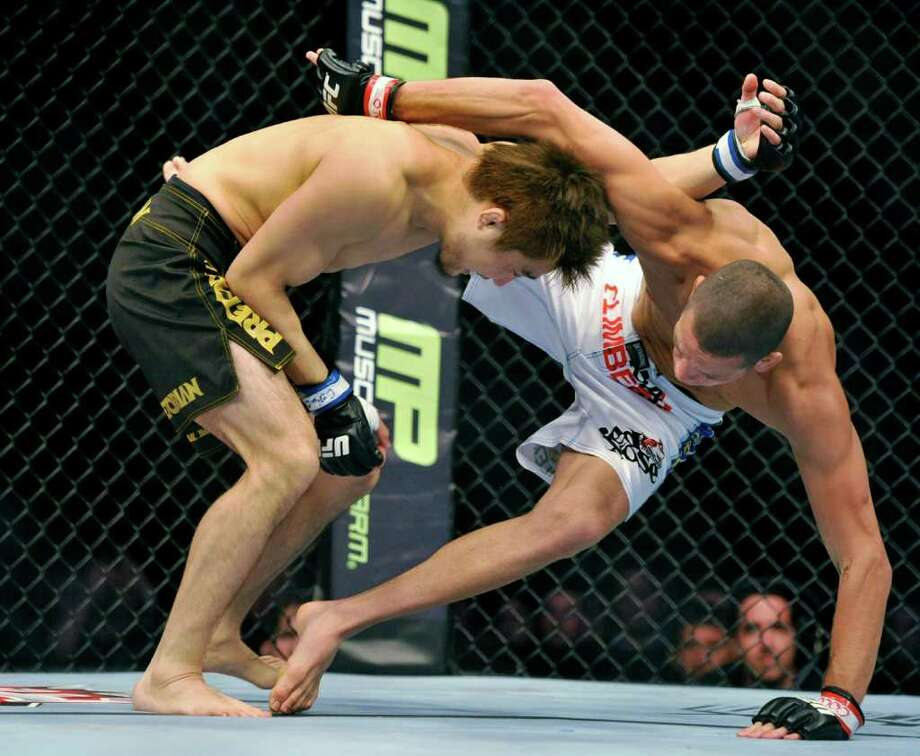 Nate Diaz, right, of Stockton, Calif., battles Takanori Gomi, of Tokyo, during their UFC Lightweight bout, Saturday, Sept. 24, 2011, in Denver. Diaz won the fight. (AP Photo/ Jack Dempsey ) Photo: Jack Dempsey, Associated Press / FR42408 AP
