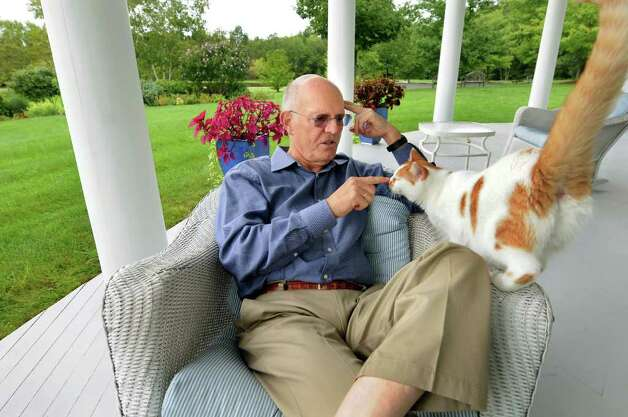Gary Knisely greets his cat as he talks about terminally-ill wife, Varian, and how she decided to take her own life, on Tuesday, Sept. 6, 2011, at his home in Old Chatham, N.Y. (Cindy Schultz / Times Union) Photo: Cindy Schultz