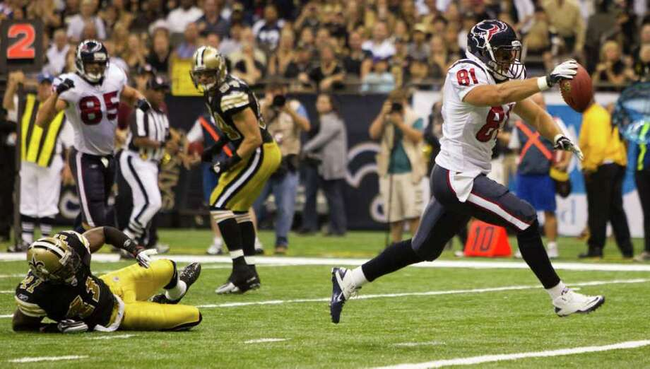 Houston Texans tight end Owen Daniels (81) runs past New Orleans Saints strong safety Roman Harper (41) for a touchdown reception during the first quarter of an NFL football game at the Louisiana Superdome Sunday, Sept. 25, 2011, New Orleans. Photo: Brett Coomer, Houston Chronicle / © 2011 Houston Chronicle