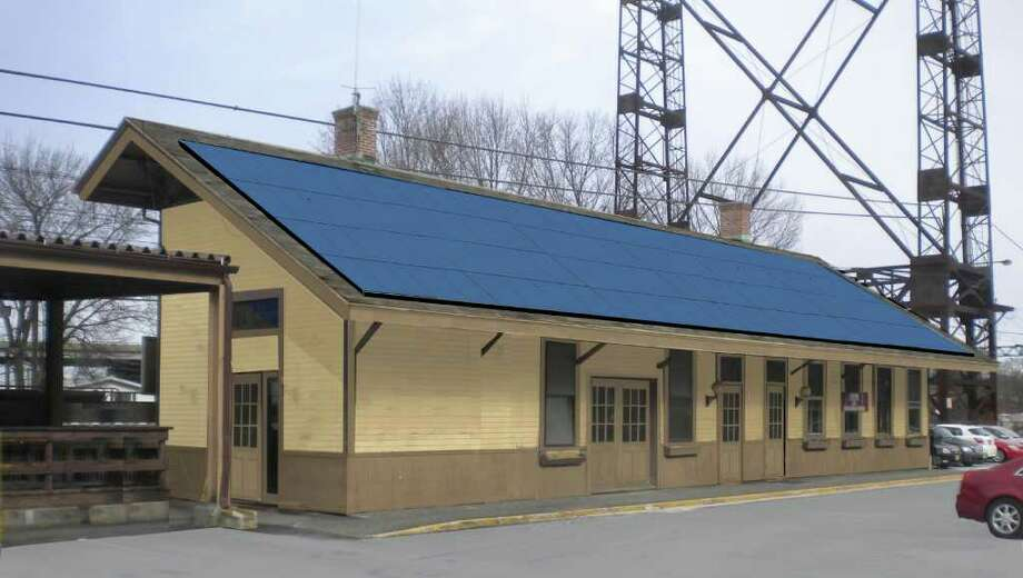 A rendering from Westport Solar Consultants, LLC shows the potential configuration of a solar panel installation at the Saugatuck Metro-North train station that would be used to power new electric vehicle charging stations. Photo: Contributed Photo / Westport News
