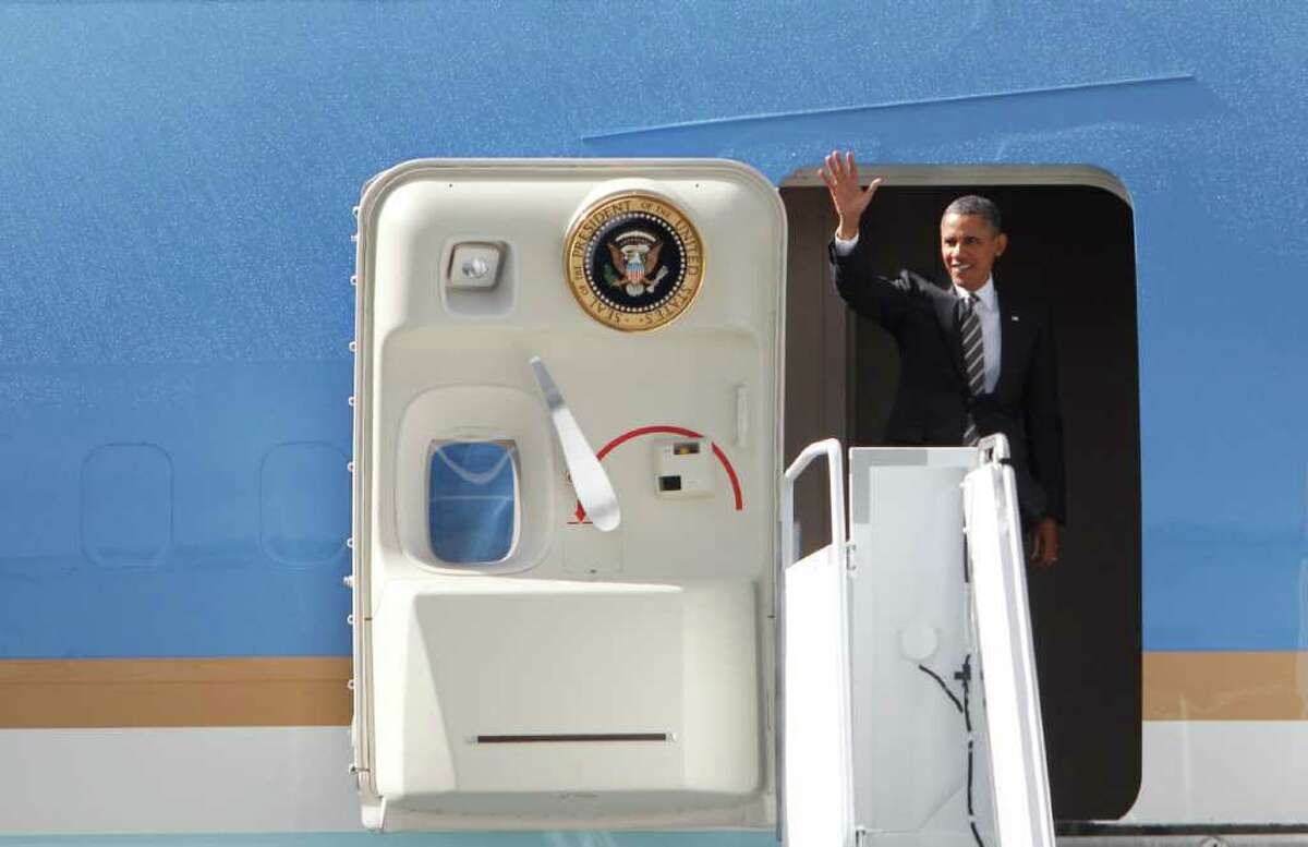 President Barack Obama waves to the crowd,