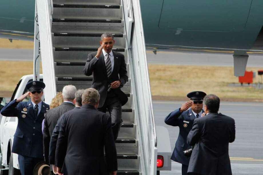 President Barack Obama salutes as he steps off Air Force One. Photo: JOE DYER / SEATTLEPI.COM
