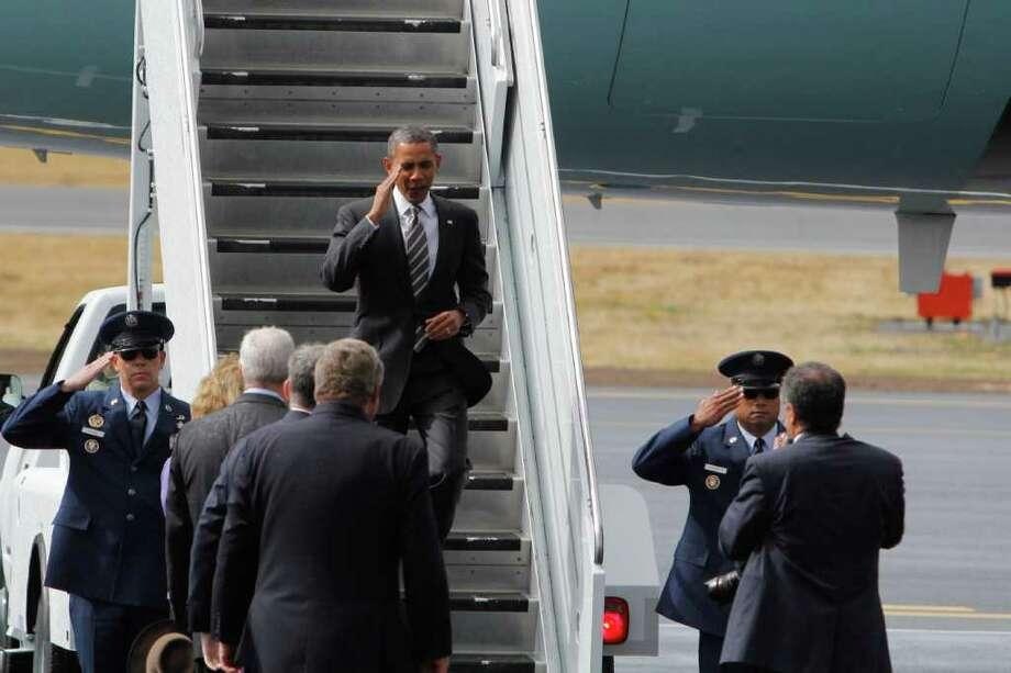 President Barack Obama salutes as he steps off Air Force One. Photo: JOE DYER / SEATTLEPI.COM