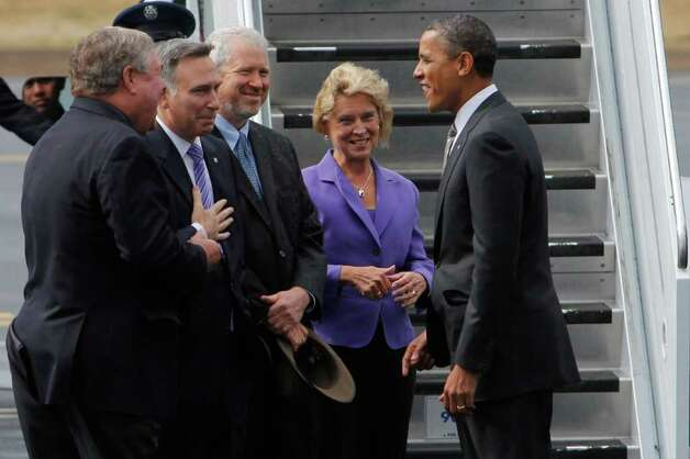 Seattle Mayor Mike McGinn and Gov. Chris Gregoire are all smiles as they greet President Obama at Boeing Field in 2011.  Appearances deceive.