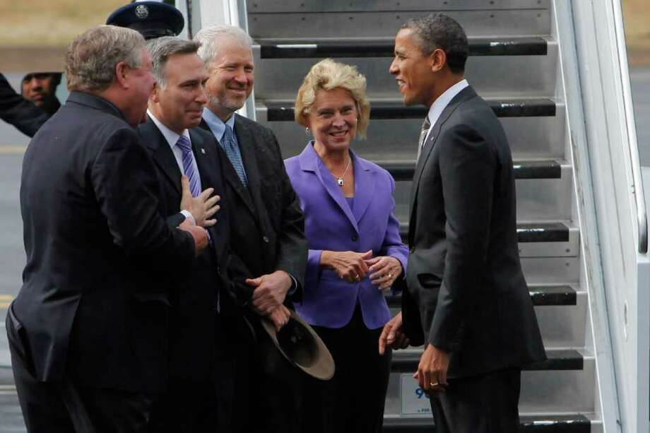 President Barack Obama greets, from left, U.S. Rep. Norm Dicks (D-Wash.), King County Executive Dow Constantine, Seattle Mayor Mike McGinn, and Washington Gov. Christine Gregoire. Photo: JOE DYER / SEATTLEPI.COM