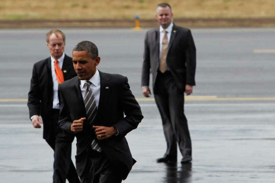 President Barack Obama jogs towards the crowd gathered at Boeing Field.