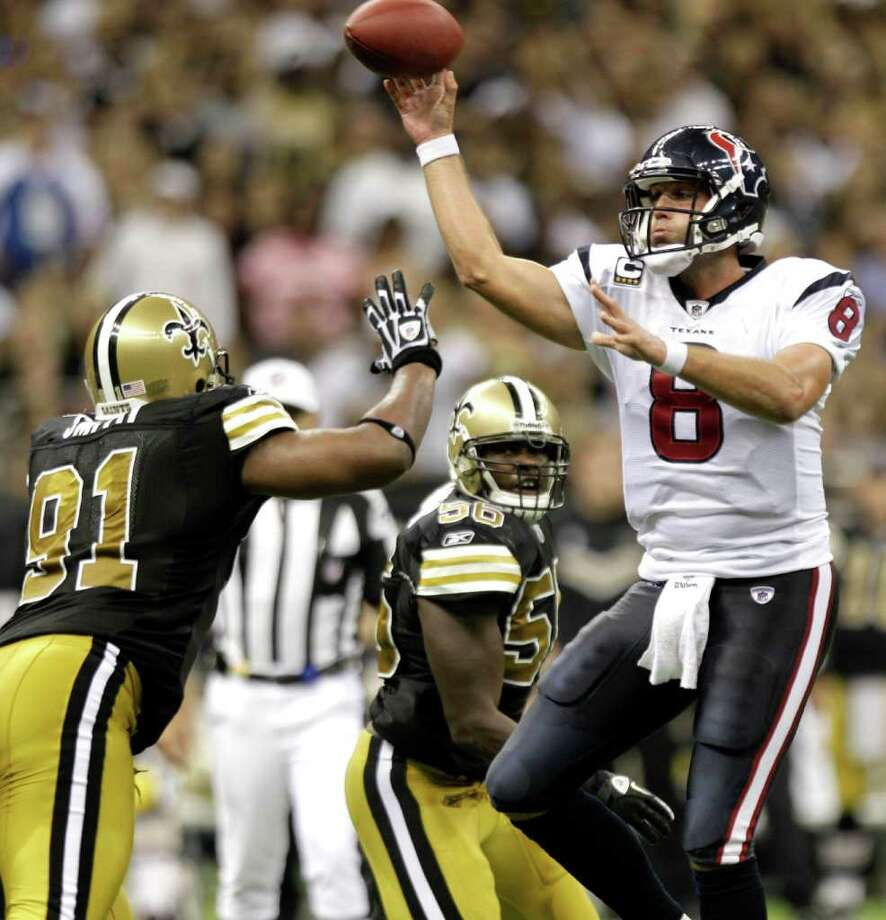 Houston Texans quarterback Matt Schaub (8) throws a pass over New Orleans Saints defensive end Will Smith (91) during the fourth quarter of an NFL football game at the Louisiana Superdome Sunday, Sept. 25, 2011, New Orleans. The Saints beat the Texans 40-33. Photo: Brett Coomer, Houston Chronicle / © 2011 Houston Chronicle