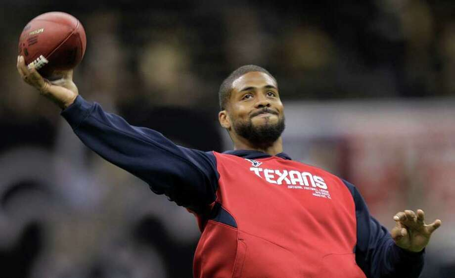 Houston Texans running back Arian Foster throws a ball before an NFL football game against the New Orleans Saints at the Louisiana Superdome Sunday, Sept. 25, 2011, New Orleans. Foster was ruled out before the start of the game. Photo: Brett Coomer, Houston Chronicle / © 2011 Houston Chronicle