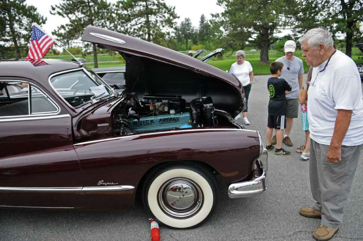A 1948 Buick owned by John Baniak of Poestenkill on display at an auto show held by the Times Union and InMotion in the newspaper's parking lot on Sunday Sept. 25, 2011 in Colonie, NY. ( Philip Kamrass / Times Union)