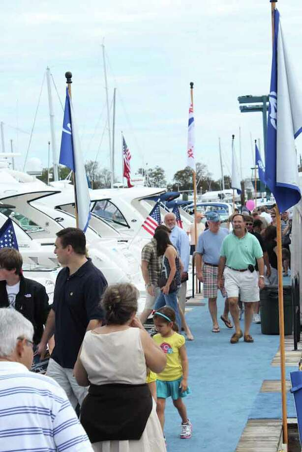 Everybody's having a great time at the Norwalk Boat Show, at the Calf Pasture Beach Marina on September 25th, 2011.  Were you seen? Photo: Mike Dominguez / Hearst Connecticut Media Group