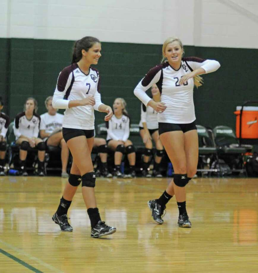 L. SCOTT HAINLINE: FOR THE CHRONICLE IN CHARGE: Clear Creek setter Courtney Richardson, left, and outside hitter Ashley Smith, No. 20, will be counted on next season to lead the Lady Wildcats through a district run. Photo: L. Scott Hainline / freelance
