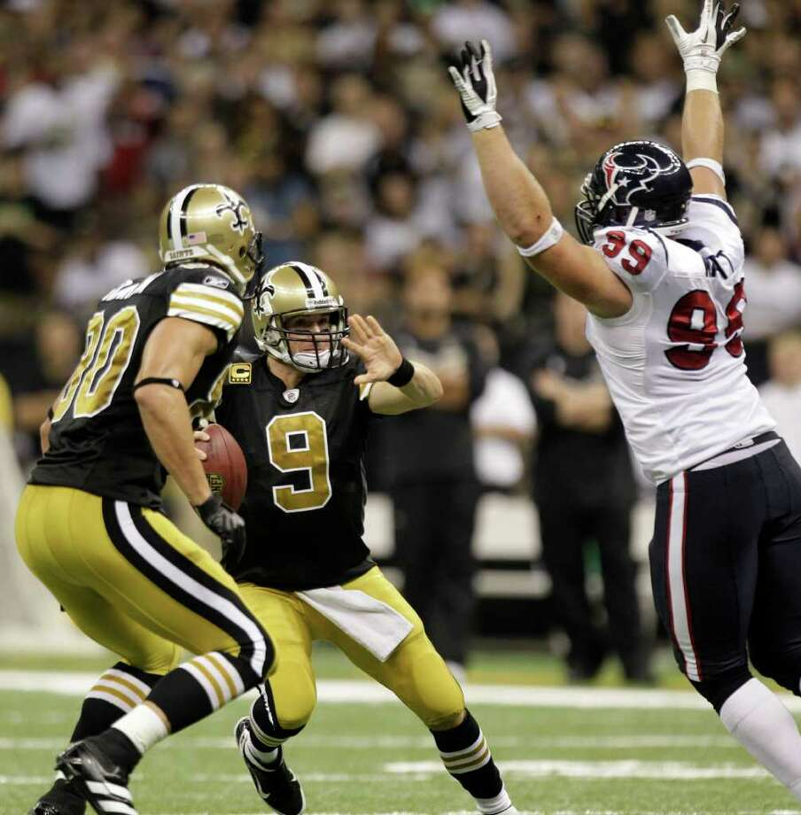 Houston Texans defensive end J.J. Watt (99) pressures New Orleans Saints quarterback Drew Brees (9) during the third quarter of an NFL football game at the Louisiana Superdome Sunday, Sept. 25, 2011, New Orleans. Photo: Brett Coomer, Houston Chronicle / © 2011 Houston Chronicle