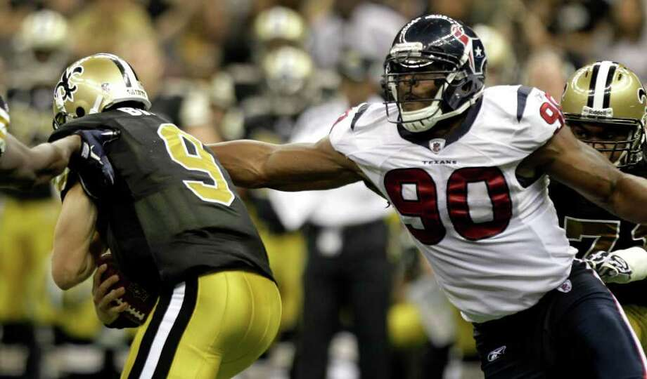 Houston Texans outside linebacker Mario Williams (90) pressures New Orleans Saints quarterback Drew Brees (9) during the third quarter of an NFL football game at the Louisiana Superdome Sunday, Sept. 25, 2011, New Orleans. The Saints beat the Texans 40-33. Photo: Brett Coomer, Houston Chronicle / © 2011 Houston Chronicle