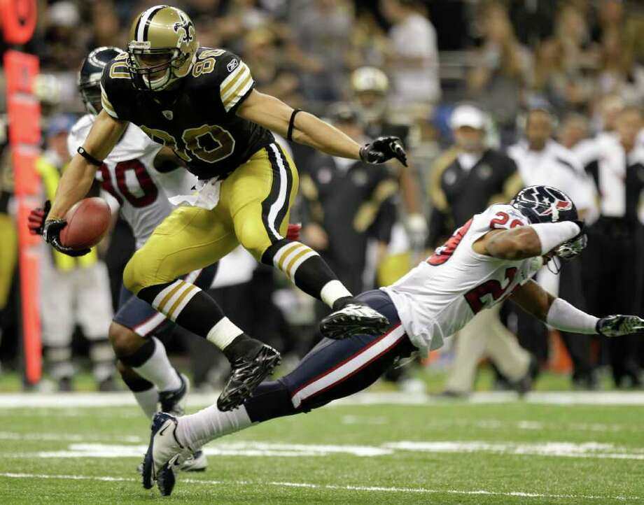 New Orleans Saints tight end Jimmy Graham (80) leaps past Houston Texans strong safety Glover Quin (29) on a 32-yard reception during the third quarter of an NFL football game at the Louisiana Superdome Sunday, Sept. 25, 2011, New Orleans. The Saints beat the Texans 40-33. Photo: Brett Coomer, Houston Chronicle / © 2011 Houston Chronicle