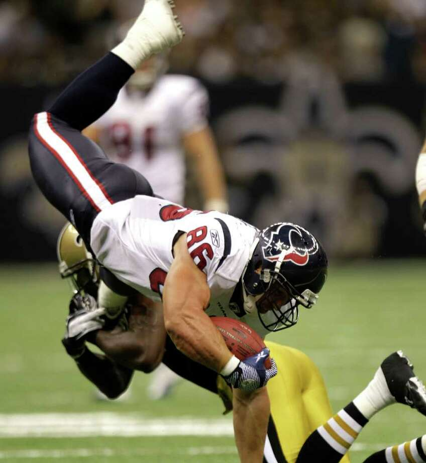 Houston Texans tight end James Casey (86) is tripped up against the New Orleans Saints during the third quarter of an NFL football game at the Louisiana Superdome Sunday, Sept. 25, 2011, New Orleans. Photo: Brett Coomer, Houston Chronicle / © 2011 Houston Chronicle