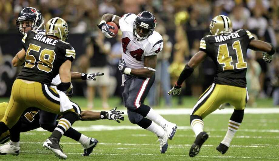 Houston Texans running back Ben Tate (44) is surrounded by New Orleans Saints outside linebacker Scott Shanle (58) and New Orleans Saints strong safety Roman Harper (41) during the second quarter of an NFL football game at the Louisiana Superdome Sunday, Sept. 25, 2011, New Orleans. Photo: Brett Coomer, Houston Chronicle / © 2011 Houston Chronicle