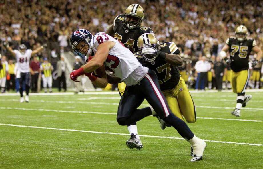 Houston Texans wide receiver Kevin Walter (83) runs past New Orleans Saints free safety Malcolm Jenkins (27) for a 20-yard touchdown reception during the fourth quarter of an NFL football game at the Louisiana Superdome Sunday, Sept. 25, 2011, New Orleans. The Saints beat the Texans 40-33. Photo: Brett Coomer, Houston Chronicle / © 2011 Houston Chronicle