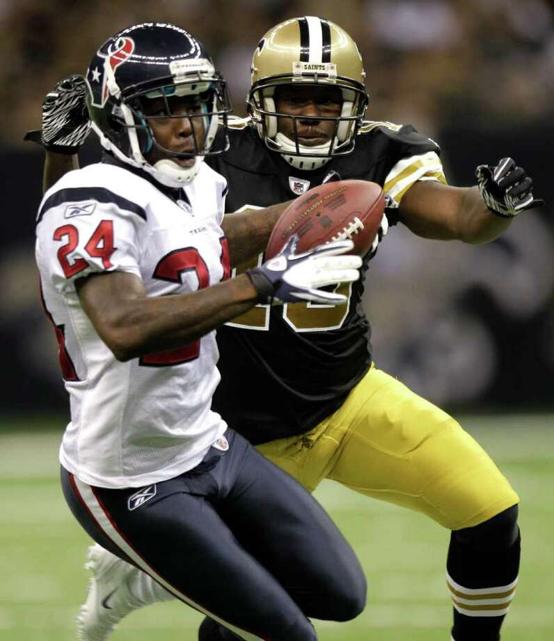 Houston Texans cornerback Johnathan Joseph (24) intercepts a pass intended for New Orleans Saints wide receiver Lance Moore (16) during the second quarter of an NFL football game at the Louisiana Superdome Sunday, Sept. 25, 2011, New Orleans. The Saints beat the Texans 40-33. Photo: Brett Coomer, Houston Chronicle / © 2011 Houston Chronicle