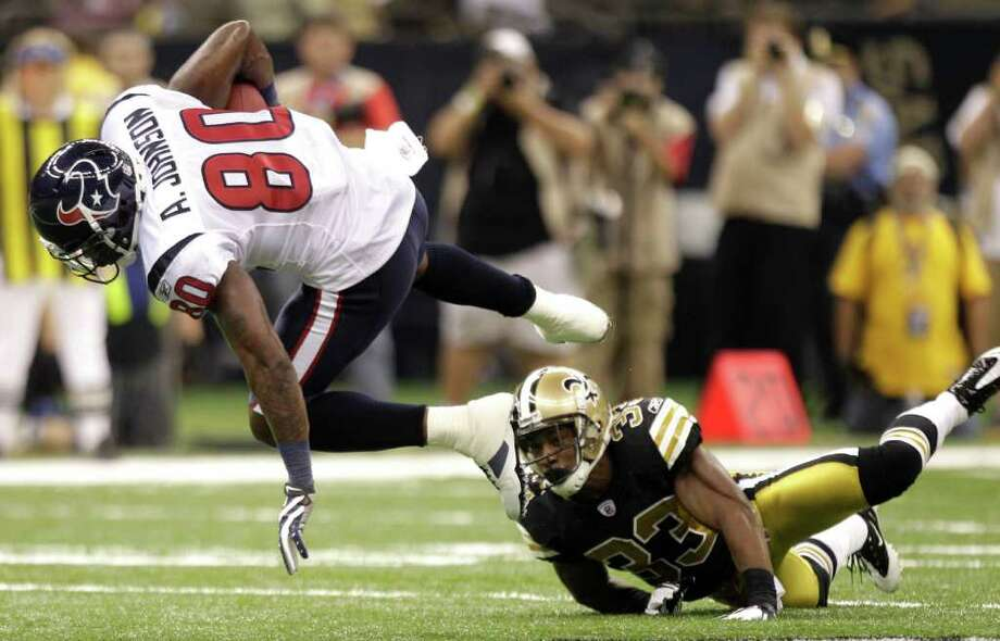 Houston Texans wide receiver Andre Johnson (80) is tripped up by New Orleans Saints cornerback Jabari Greer (33) during the second quarter of an NFL football game at the Louisiana Superdome Sunday, Sept. 25, 2011, New Orleans. The Saints beat the Texans 40-33. Photo: Brett Coomer, Houston Chronicle / © 2011 Houston Chronicle