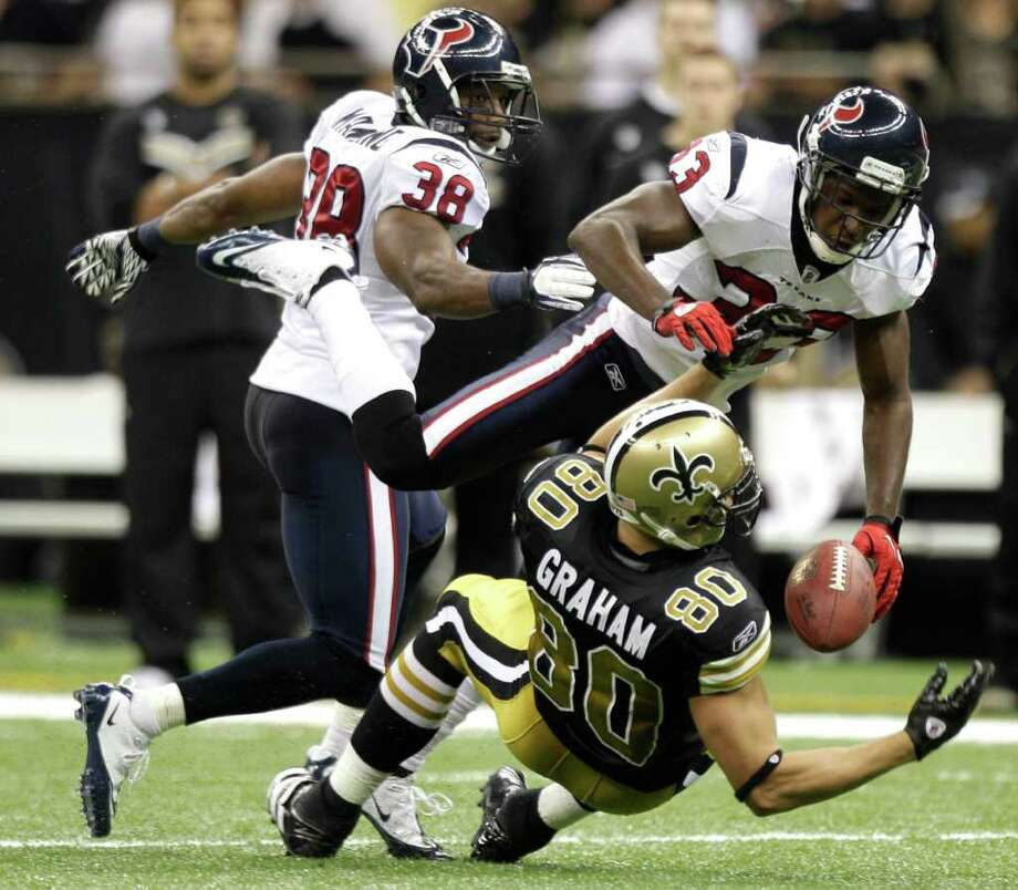 Houston Texans defensive back Troy Nolan (33) breaks up a pass intended for New Orleans Saints tight end Jimmy Graham (80) during the third quarter of an NFL football game at the Louisiana Superdome Sunday, Sept. 25, 2011, New Orleans. Photo: Brett Coomer, Houston Chronicle / © 2011 Houston Chronicle