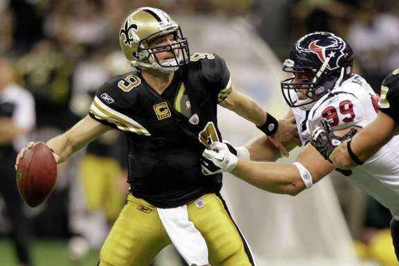 New Orleans Saints quarterback Drew Brees (9) is sacked by Houston Texans defensive end J.J. Watt (99) during the third quarter of an NFL football game at the Louisiana Superdome Sunday, Sept. 25, 2011, New Orleans.