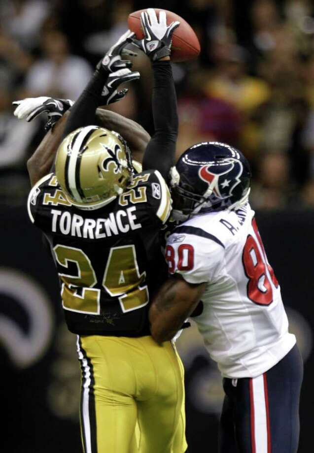 New Orleans Saints defensive back Leigh Torrence (24) breaks up a pass intended for Houston Texans wide receiver Andre Johnson (80) during the fourth quarter of an NFL football game at the Louisiana Superdome Sunday, Sept. 25, 2011, New Orleans. The Saints beat the Texans 40-33. Photo: Brett Coomer, Houston Chronicle / © 2011 Houston Chronicle