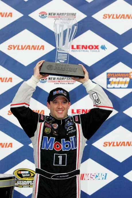 LOUDON, NH - SEPTEMBER 25:  Tony Stewart, driver of the #14 Mobil 1/Office Depot Chevrolet, celebrates with the trophy in victory lane after he won the Sylvania 300 at the New Hampshire Motor Speedway at New Hampshire Motor Speedway on September 25, 2011 in Loudon, New Hampshire.  (Photo by Geoff Burke/Getty Images for NASCAR) Photo: Geoff Burke / 2011 Getty Images
